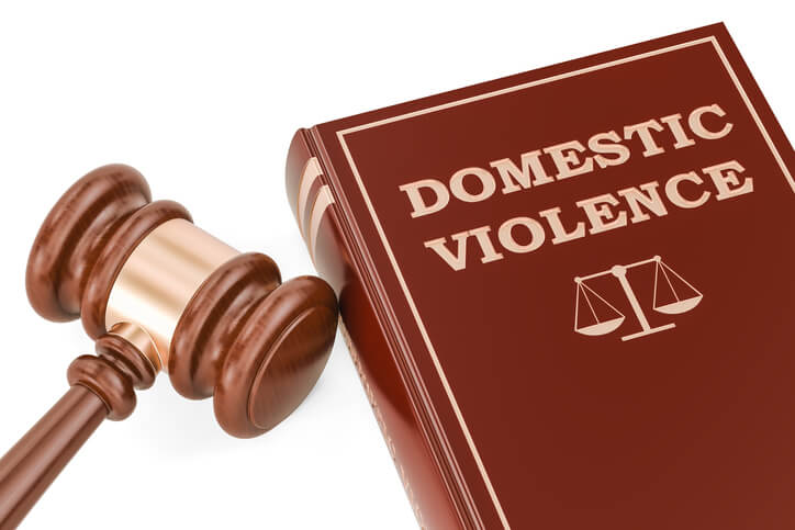 Domestic violence concept with gavel and book