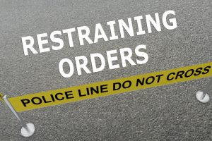 illustration of Restraining Orders title on the ground in a police arena