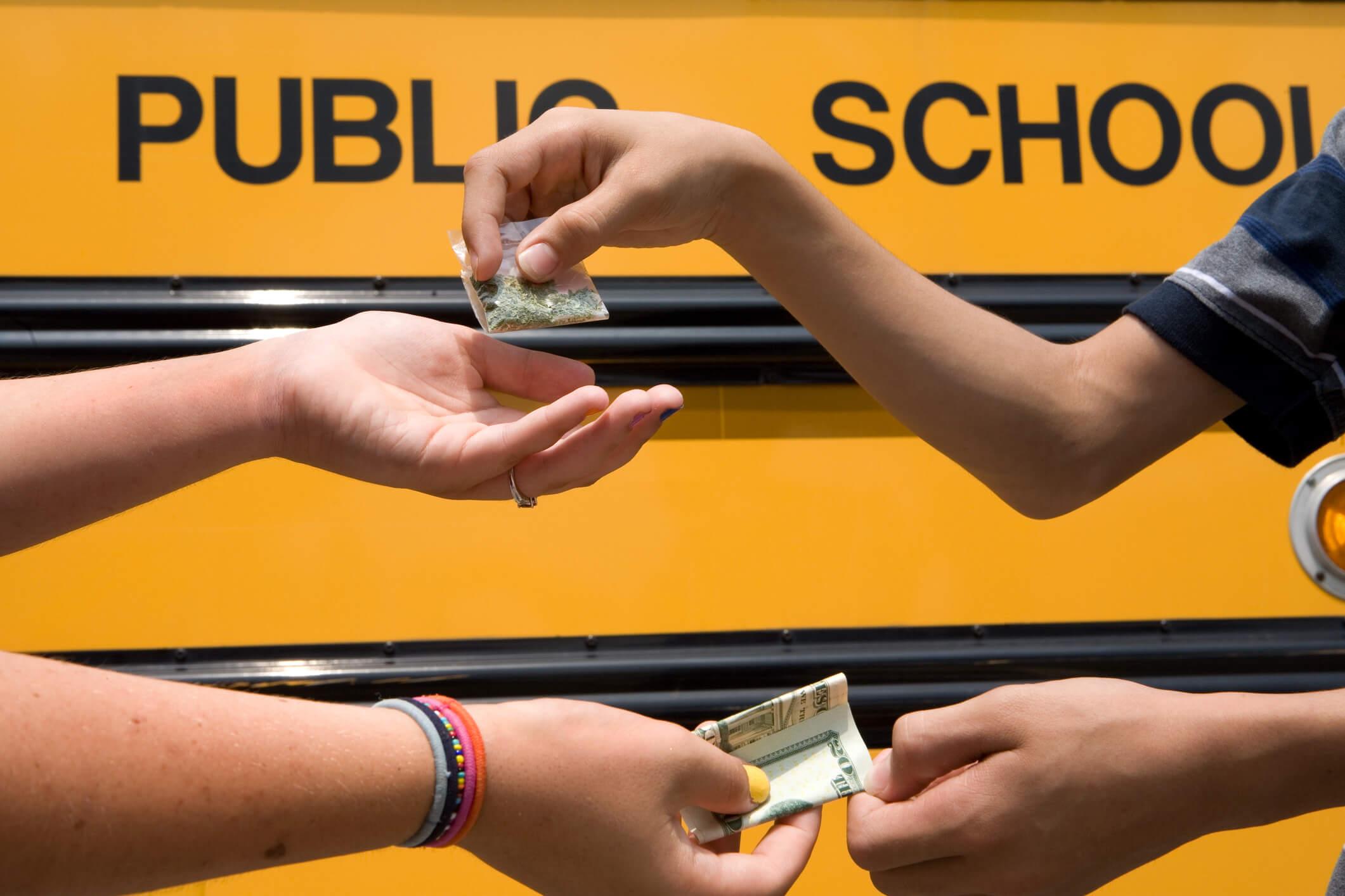 2 children making a drug exchange.