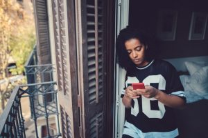 woman at home text messaging