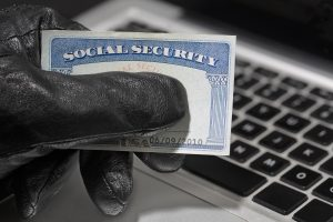 Thief holding a social security card